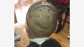 Kid gets Mario's face shaved into his head.
