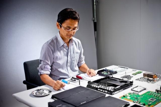 Man takes apart PS4.
